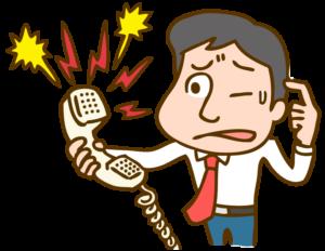 クレーム電話の対応をする男性のイラスト